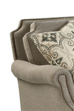Scalloped Cushions and Nailhead Trim Add a Touch of Elegance to a Comfortable Piece