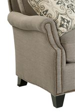 Sofa Hugged by Tightly Rolled Arms with Sloped Detailing