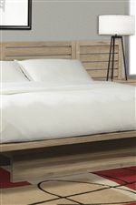 Beautiful Cantilevered Platform Bed Features Simple Horizontal Paneling in Headboard