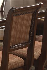 Seat Back Features Subtle Curves, Carved Detail and Attractive Striped Upholstery