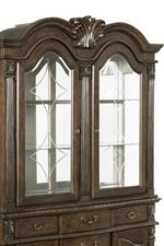 Traditional cupid's bow china hutch on china cabinet creates a look with Old World elegance