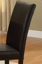 Upholstered Chairs Feature Curved Seat Backs with Accent Stitching