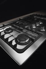 Continuous Grates Allow You to Move Even the Heaviest Pots and Pans from Burner to Burner with the Utmost Ease