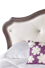 Upholstered Headboard Accented with Nailhead Trim and Diamond-Rhinestone Tufting