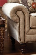 Traditional Rolled Arms with Nail Head Trim Add Classic Elegance to a Living Room Display