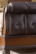 Upholstered Sleigh Bed with Tuft and Nailhead Detailing