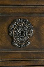 Select Drawer Fronts Feature Worked Metal Escutcheons