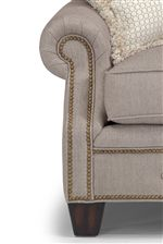 Rolled Panel Arms, Nailhead Studs, and Tapered Legs Create a Sophisticated Appeal