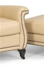 Sleek, Flared Arms and Legs Highlighted by a Nailhead Border