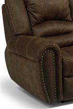 Padded Rolled Arms Are Accented With Large Nailhead Trim and Contrast Stitching