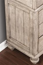 Paneled Sections, Molding, and Turned Feet Create Classic Look