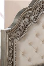 Button-Tufted Upholstered Headboard with Intricate Nailhead Trim and Carvings