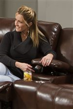 A Storage Console and Cup-Holders in the Loveseat Offer Convenience