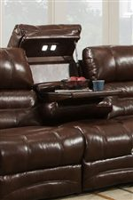 The Center Sofa Seat Features a Drop Down Table