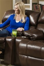 Cup-holders are built into this collection's loveseat for a movie theater like convenience