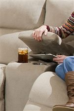 Cup-Holders and a Storage Compartment in the Console Loveseat add Fun and Convenience to this Collection