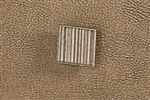 Textured Square Metal Knob in a Champagne Finish Featured on Doors