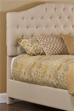 Curved Headboard with Tufted Accents and Warm Beige Color