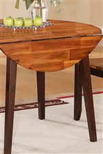 Round Table Comes Equipped with Two Drop Leaves for Space-Saving Dining