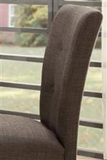 Button Tufting and Brown/Gray Tone Lends a Menswear Feel to Side Chairs