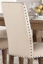 Nailhead Trim on Neutral Tone Upholstered Chair