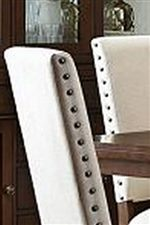 Nailhead Trim Decorates the Side of the Chairs