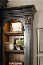 Bold wood carvings and molding features in entertainment wall unit