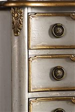 Carved Corner Pieces and Gilded Edging