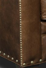 Two Sizes of Nailhead Trim Decorate the Dark Brown Leather