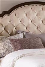 Diamond Tufting on the Upholstered Headboard gives a look of Traditional Romanticism