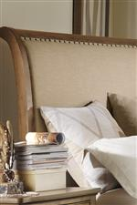 Linen Upholstery Pairs with the Caramel Finish for a Fresh, Organic Look