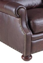 Rolled Pillow Topped Arms Adorned with Nailhead Trim and Paired with Bun Feet