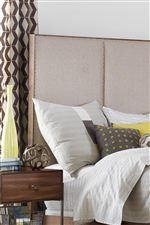 Neutral Upholstered Accents Instill Pieces with Relaxed Contemporary Style