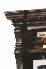 Ornately Carved Columns and Crown Moulded Case Tops