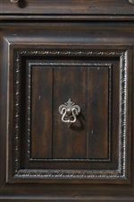 Intricate Carvings Decorate Drawer and Door Fronts