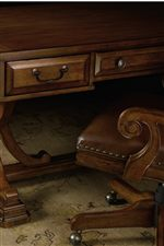 Raised Border Drawer Fronts and Graceful Scroll Arms