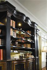 Shaped Bookcase Top with Elegant Carved Moldings.