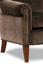 Tall, Tapered Legs and Rolled Arm with Sophisticated Nailhead Trim