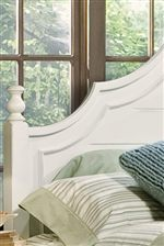 Sculpted Headboard Detail with Trumpet Bed Posts
