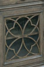 Select Pieces Feature Tempered Glass Doors with Intricate Tracery