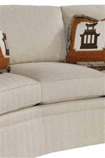 Curved Sofa Shape Accented with Square Cushions and Skirted Base