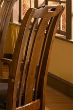 The Collection Has Two Sets of Dining Chairs that Both Feature Slat Backs