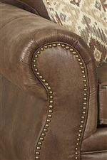 Oversize Rolled Arms Accented by Nailhead Trim and Pleats