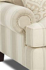 Rolled Arms with Nailhead Trim and Pleats Create Classic Look