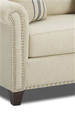 Nailhead Trim Decorates the Paneled Arms and Bottom of the Furniture