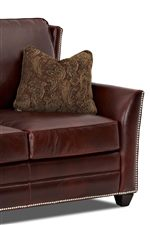 Accent arm pillow enhances the look of the sofa.
