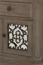 Select pieces boast scrolled grilles or antiqued mirror