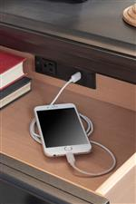 Features like built-in outlets add modern convenience