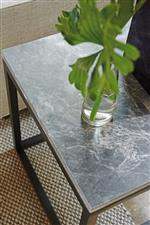 Select pieces feature the bold, natural texture of Bahia marble