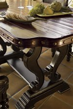 Nail head trim on the Sienna Bistro Table is featured on pieces throughout the collection